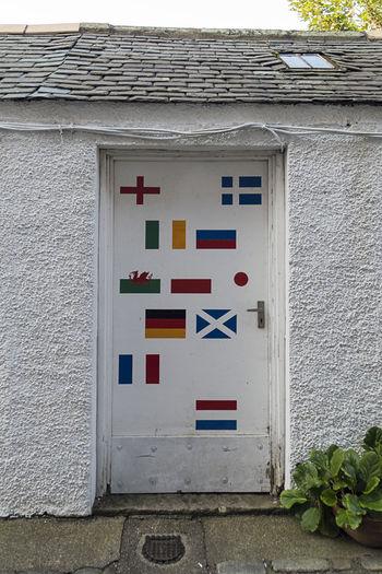 International Doorway International Old Town Architecture Building Exterior Built Structure Country Flags Day Door Handle No People Outdoors White Door