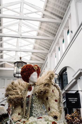 Fleurs de Villes Floral Couture Installation in Covent Garden Market Building. Architecture Built Structure Day Luxury Couture Fashion Blossom Springtime London Uk England Covent Garden  Covent Garden Market Floral Fleurs Landmark Extravaganza Shopping Artist Flower Indoors  No People Ceiling Low Angle View Focus On Foreground Decoration Stuffed Toy Teddy Bear Plant Nature Representation Close-up Hanging Still Life Art And Craft