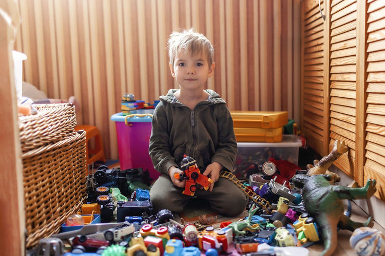 Portrait of boy playing with toys at home