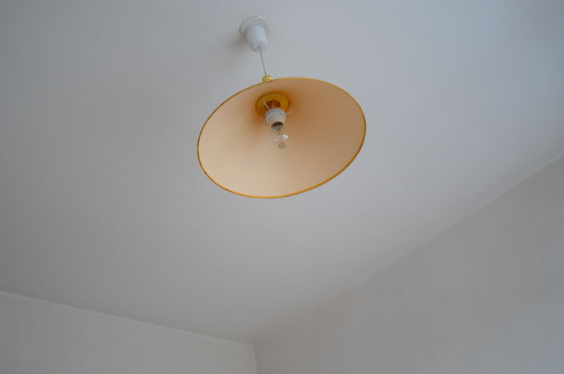Low angle view of light hanging from ceiling