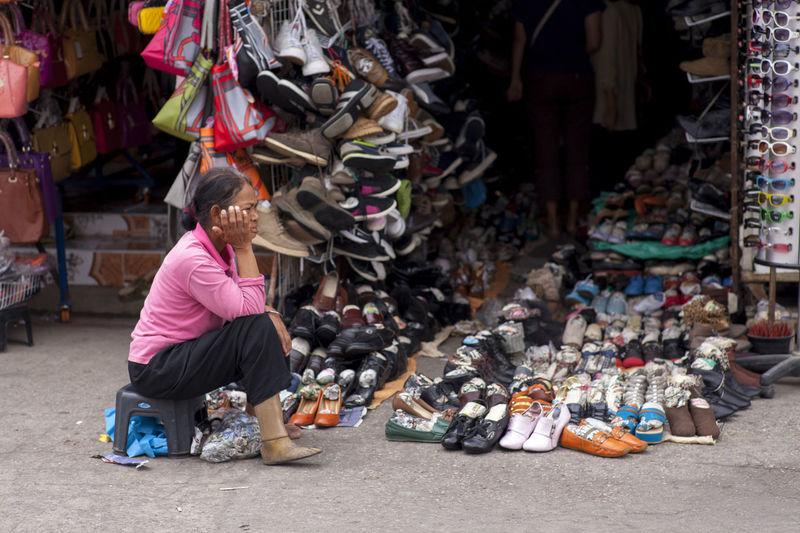 Shoe salesman, who with no legs No Legs, Artificial Legs Abundance Choice Day Indoors  Large Group Of Objects Market One Person People Real People Retail  Shoes Shoes Store Used Shoes