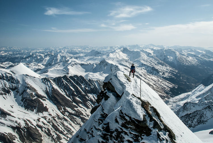 Adults Only Adventure Challenge Climbing Cold Temperature Day Extreme Sports Full Length Grossglockner Highest Peak Of Austria Landscape Mountain Mountain Range Mountaineering One Person Only Men Outdoors Peak People Ridge Scenics Sky Snow Steep Winter