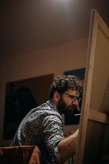 Man looking at camera at home