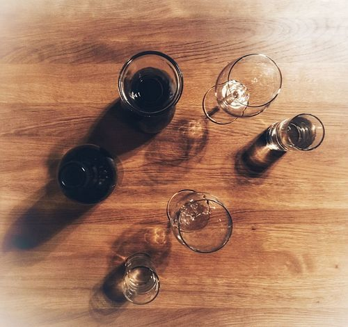 -- Red or White or Water? -- Table Wood - Material Indoors  Food And Drink High Angle View Alcohol Shot Glass Wine Moments Wine And Dine  Wine Moments. Wine Shop Wooden Table Water In Glass On Table Drinking Glass Close-up