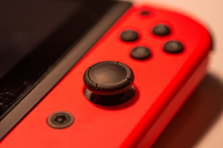 nintendo switch gaming console controller close up Technology Control Red Arts Culture And Entertainment Close-up Music Number No People Push Button Knob Single Object Indoors  Communication Electrical Equipment Studio Shot Noise Sound Recording Equipment Audio Equipment Keypad Rock Music Antique