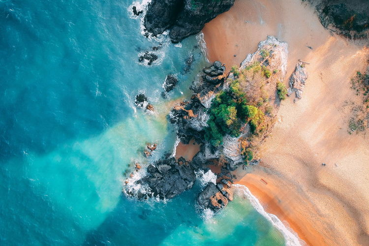 Water Sea High Angle View Nature Beauty In Nature Day Solid Land Rock Rock - Object Scenics - Nature Outdoors Beach Real People Tranquility Tranquil Scene Lifestyles Non-urban Scene Turquoise Colored Swimming Pool