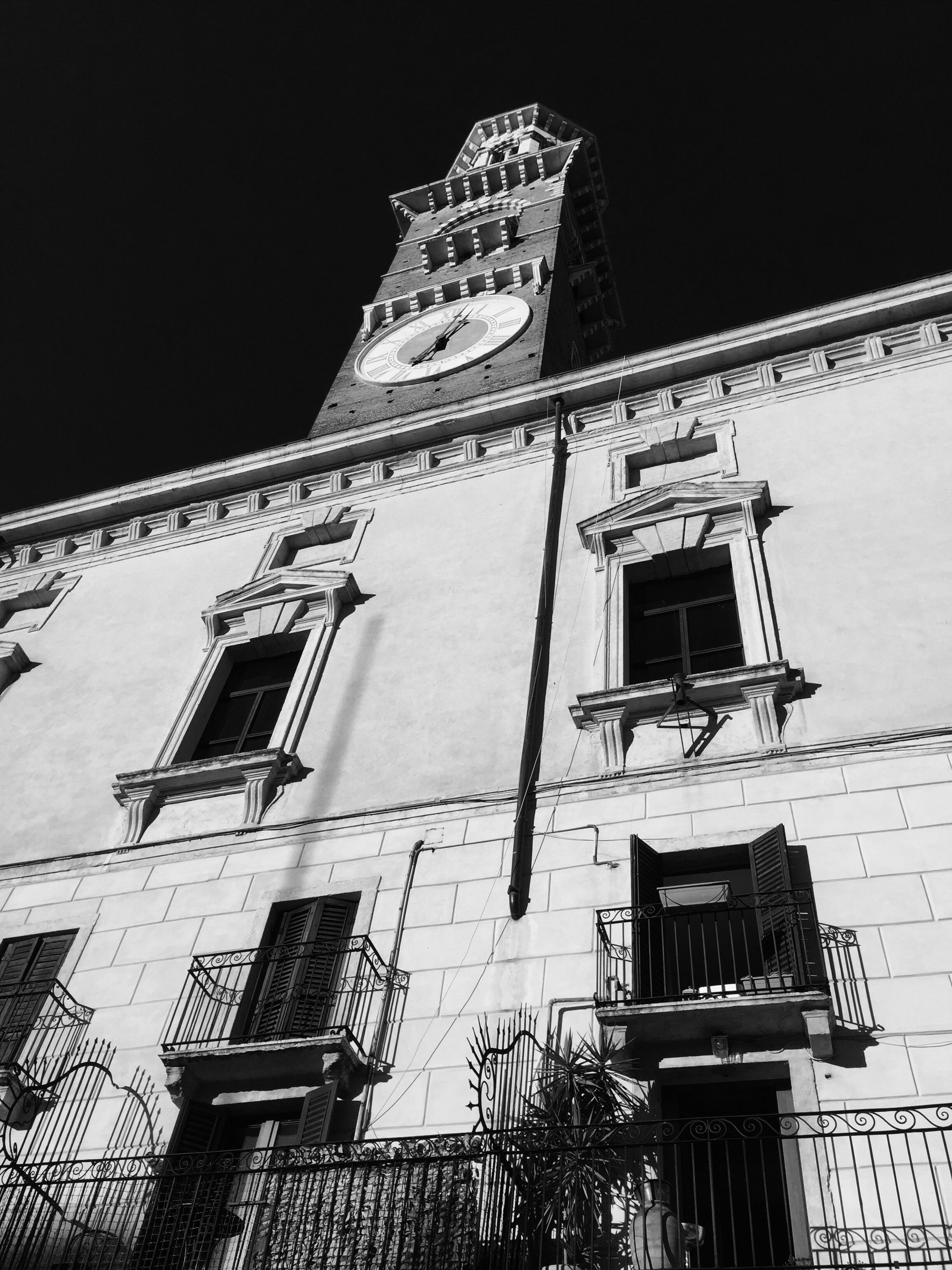 low angle view, architecture, building exterior, built structure, window, balcony, sky, outdoors, day, facade, high section, history, no people, spire
