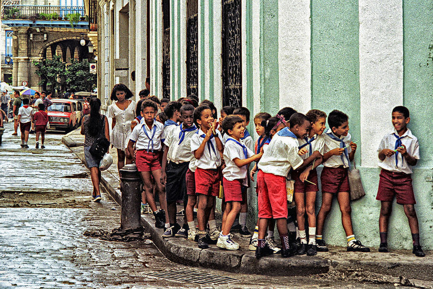 Out of sight of teacher in Havana Children Cuba Cuban Fun Giggle Group Havana In A Row Laughter Naughy Outdoors School Side By Side Street Photography Teacher Uniform