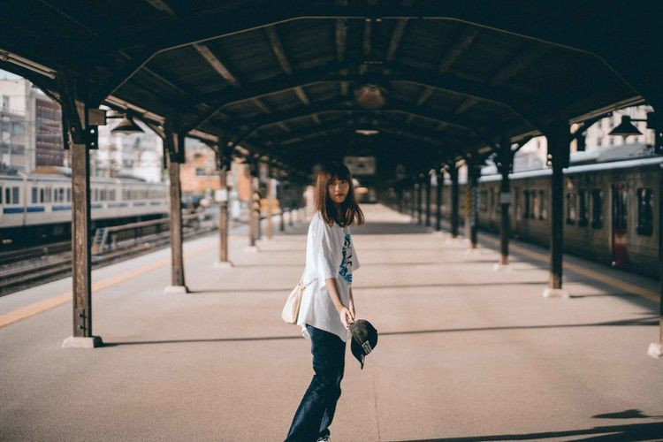 Full length of woman on railroad station