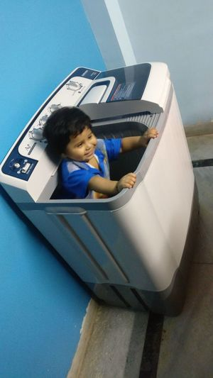 Little Boy Sitting In Washing Machine Playing Playing Alone Child Children Only One Person Childhood One Boy Only Boys People