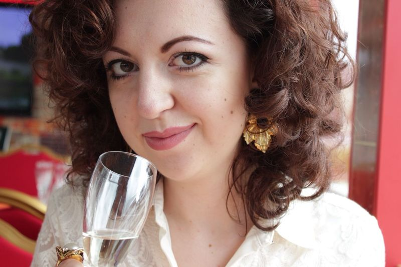 Close-Up Portrait Of Woman Holding Champagne Flute