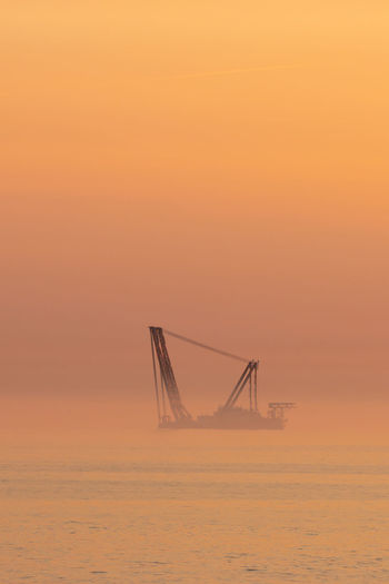 Heavy industry wind turbine installation barge off the dutch coast, building an offshore wind park
