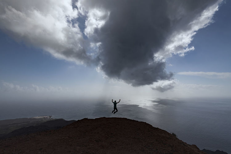 Cloud Freedom Jump La Palma Island La Palma, Canarias Beauty In Nature Cloud - Sky Clouds And Sky Day Full Length Horizon Horizon Over Water La Palma Leisure Activity Lifestyles One Person Rock - Object Scenics Sea Sea And Sky Sky Tranquil Scene Water