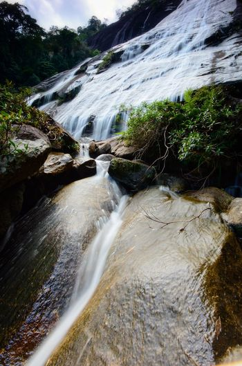 Natural Waterfall at Gunung Stong, state park Kelantan, Malaysia Wallpaper Background Malaysia ASIA Amazing Nature Water Waterfall Tree Forest Motion River Mountain Landscape Sky Flowing Long Exposure Flowing Water Power In Nature Natural Landmark