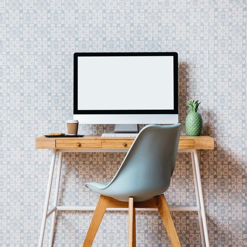 Blank Desktop Pc On Table By Chair Against Wall At Home
