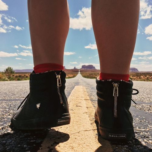 Sneakers On The Road Low Section Human Leg Shoe Sky Day Sunlight Cloud - Sky Outdoors Sand Beach Human Body Part Standing Sea One Person Nature Real People Water Close-up People Out Of The Box The Fashion Photographer - 2018 EyeEm Awards Summer Road Tripping