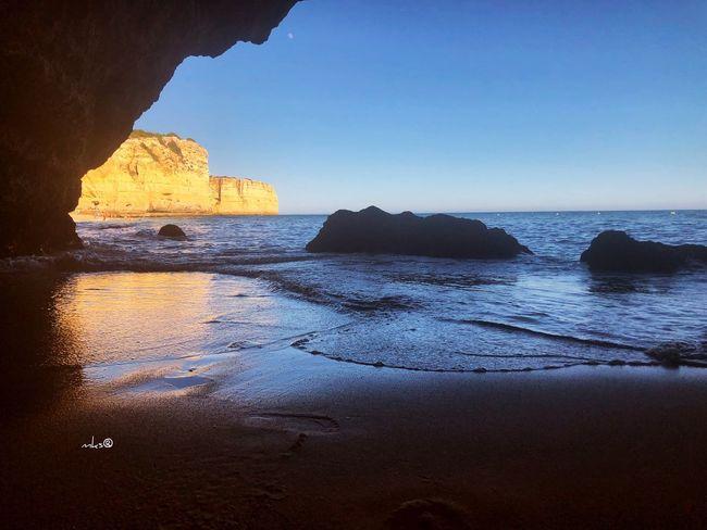 Hidden Sunset Algarve Photography Bestoftheday EyeEm Best Shots Travel Destinations Beauty In Nature Beach Sea Water Sky Land Rock Horizon Over Water Scenics - Nature Beauty In Nature Rock - Object Tranquil Scene