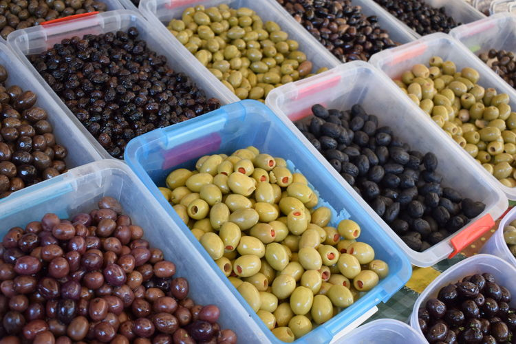 Olive Abundance Black Olive Choice Container Food Food And Drink For Sale Freshness Fruit Green Olive Healthy Eating High Angle View Large Group Of Objects Market Market Stall No People Olive Retail  Sale Street Market Variation Wellbeing