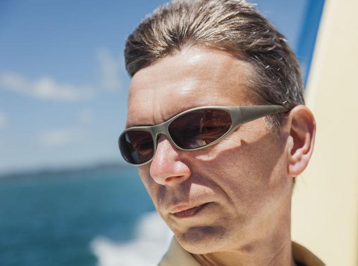 Man Wearing Sunglasses Against Sea