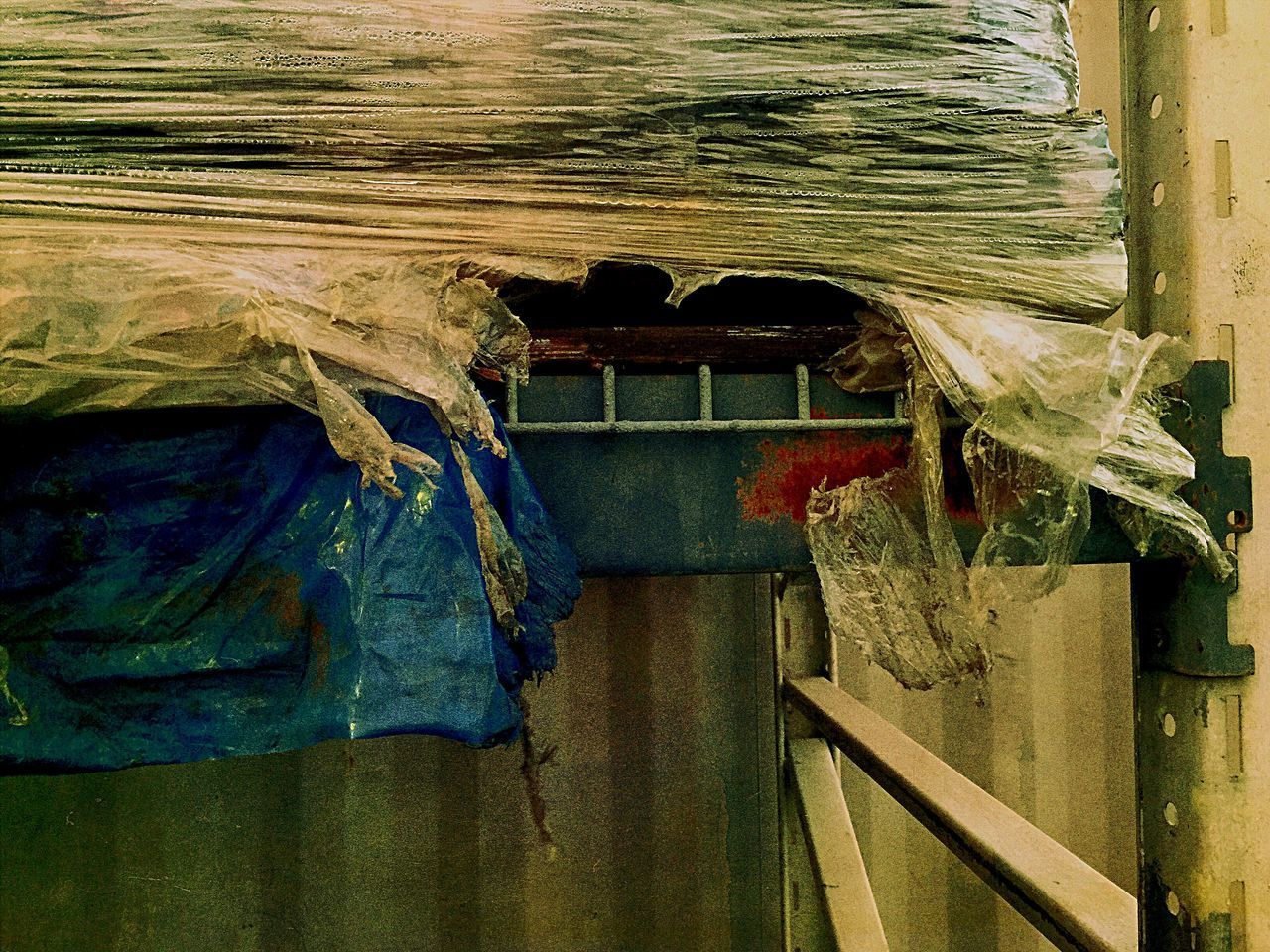 no people, day, wood - material, indoors, still life, hanging, textile, close-up, architecture, clothing, old, nature, container, plant, blue, plastic, focus on foreground, abandoned