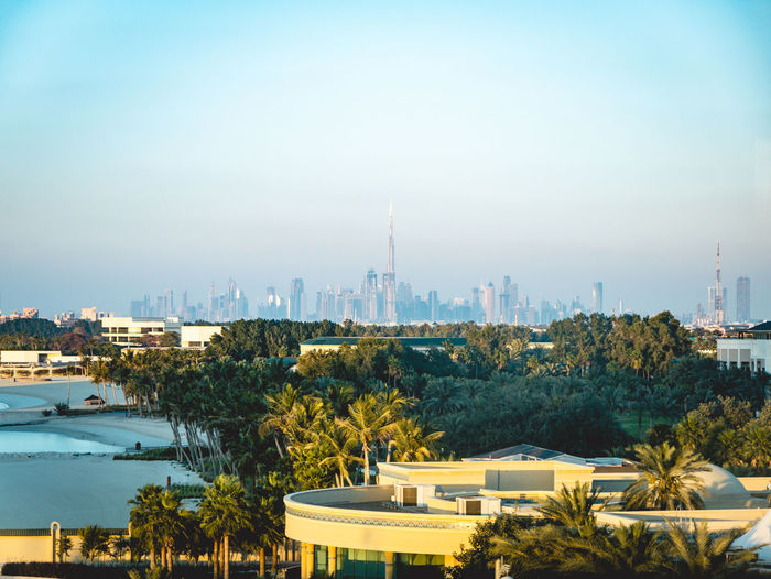 Skyline of Dubai Burj Khalifa Sunset Day Blue Sky Sky Plant Nature Building Exterior Built Structure Tower Travel Destinations Office Building Exterior Towers Skyscraper Tourism Tall - High Outdoors Travel No People Architecture Spire  Cityscape City Skyline Dubai Skyline Dubai