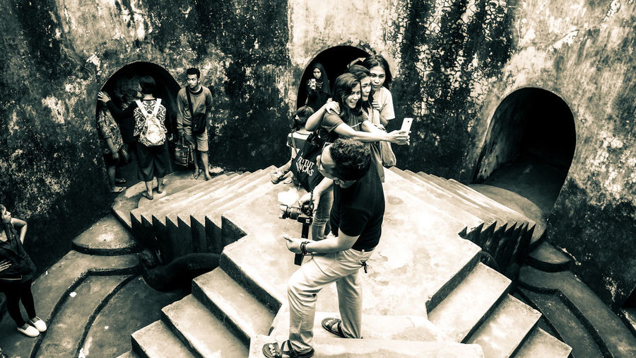 People activity in taman sari jogja Streetphotography Peoples Oldschool Vintage Photo Activity Human Interest Indonesia Human Interest Vintage Crowded Oldbuilding Old Building Exterior Old Building  Historical Building Split Toning Split Toned