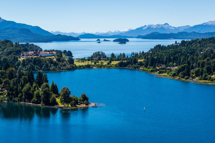 Lago Nahuel Huapi... Water Mountain Scenics - Nature Beauty In Nature Tree Sky Tranquil Scene Tranquility Plant Blue Waterfront Nature No People Mountain Range Sea Non-urban Scene Day Idyllic Outdoors Bay Lake Tourism Travel Destinations Aroundtheworld Scenics