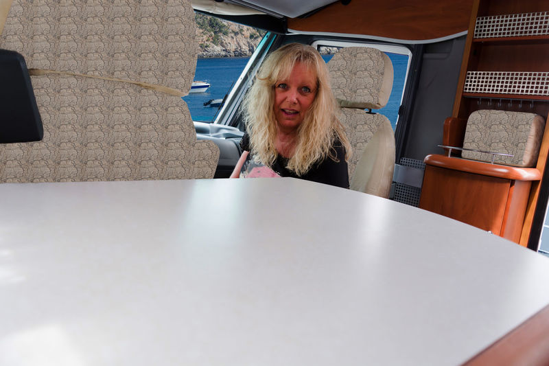 Elderly woman sitting in the passenger seat in a motor home and looking at the camera. Travel Adult Adults Only Blond Hair Camervan Camper Campervan Car Casual Clothing Day Headshot Indoors  Long Hair Mobile Home Mode Of Transport Motorhome Older Woman One Person People Portrait Real People Sitting Transportation Young Adult