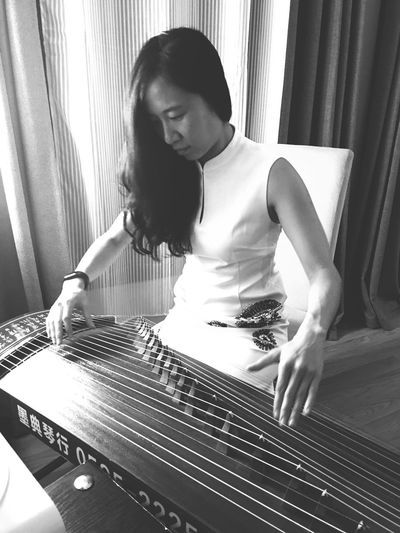 Woman Playing Zither