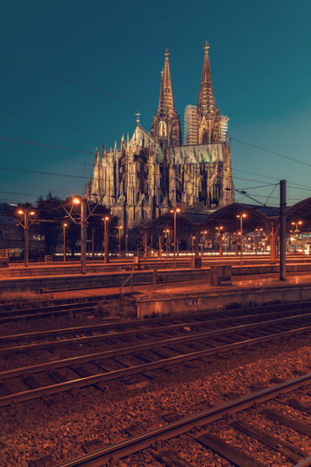 train in motion, Cologne. Cologne Cathedral Cologne Cathedral Cologne Germany Train In Motion Train Train Station Track Railroad Track Rail Transportation Architecture Built Structure Building Exterior Transportation Place Of Worship Religion Sky Belief Spirituality Nature No People Illuminated Mode Of Transportation Building City Spire