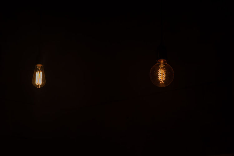 Load shedding Lighting Equipment Dark Illuminated Light Bulb Copy Space Electricity  Hanging No People Glowing Indoors  Light Black Background Light - Natural Phenomenon Filament Low Angle View Darkroom Technology Night Electric Lamp Domestic Room Luminosity Power Supply Load Shedding