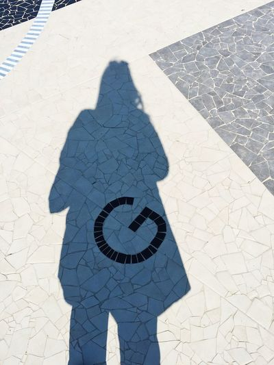 Abstract G spot with G letter on the floor Funny G G Spot! Sign Abstract Childhood Day Floor G Point Girl High Angle View Low Section Meaning One Person Outdoors Pavement People Real People Shadow Sunlight Sunny Day