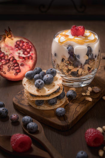 Breakfast Blue Blueberries Breakfast Cereals, Close-up Day Food Fruits Fruits ♡ Indoor, Pancakes Pomegranate Raspberries Red Sweet Tabletop White Wood-material Yellow Yoghurt
