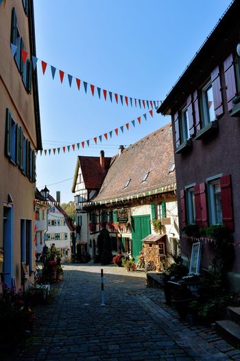 Bunting City House Sky Architecture Building Exterior Built Structure Residential District TOWNSCAPE Town Lantern Clothesline Tiled Roof