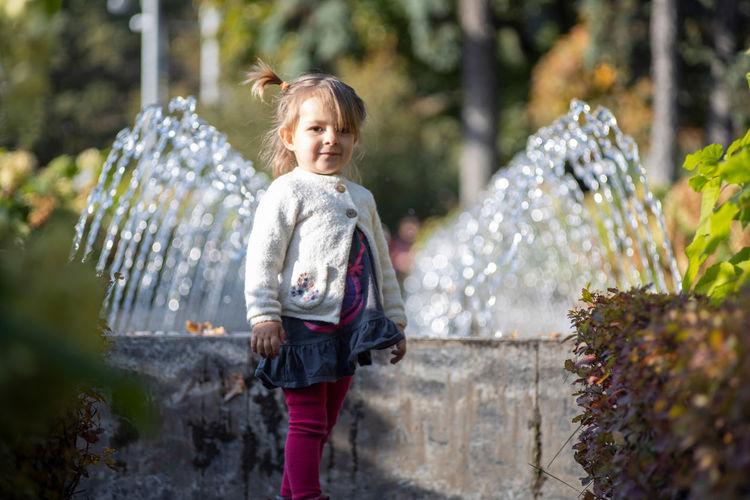 Full length of girl standing in water