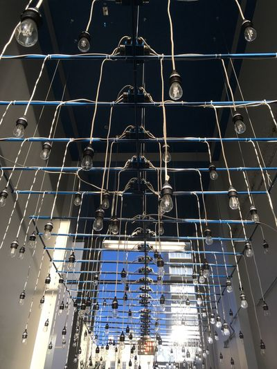 Low Angle View Of Light Bulbs Hanging From Ceiling