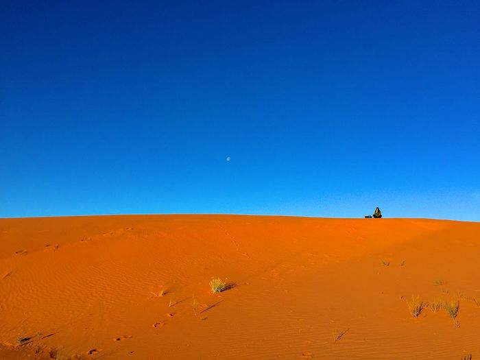 View Of Desert Against Clear Blue Sky