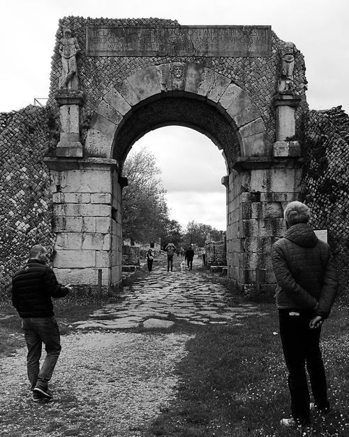 Sepino Gate Adult Arch Architecture Building Exterior Built Structure Day Full Length History Incidental People Leisure Activity Lifestyles Men Nature Outdoors People Real People Rear View Roman Architecture Sky Stone Wall The Past Walking Warm Clothing Women