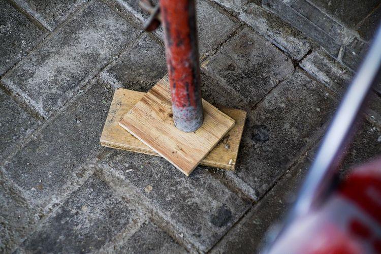 High angle view of metal chain on floor