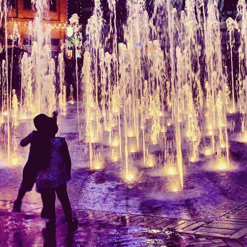 Water Rear View Night Nature Outdoors Spraying Warm Clothing Children Childhood Playing Playful Real People Real Life Cellphone Photography Popular On Eyeem The Week On EyeEm EyeEmNewHere Cellphoneshot Cellphonephotography Streetphotography Water Fountain Fountains