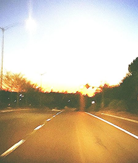Sunset to the west on the long way home. Orange Sunset Orange To Black From My Point Of View Roadway Highwayphotography Blindshot