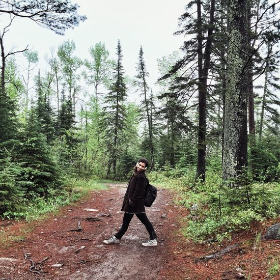 Hiking near Lake Superior. Full Length Tree One Person Forest Day Pinaceae Adults Only Pine Tree Nature Outdoors Adult People Beauty In Nature Sky Woman Woman Portrait Millenials Hiking Hiking Trail Minnesota Minnesota Nature Spring Springtime Lake Superior Lake Superior Shore