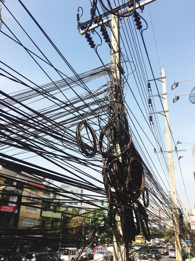 Cable Tangle Power Line  Transportation Sky Outdoors Low Angle View Power Supply Connection Electricity  City Day Mode Of Transport Electricity Pylon City Life Building Exterior Built Structure Complexity Architecture Telephone Line No People