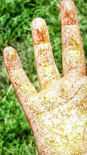 Close-up Focus On Foreground Grass Hand Gold Golden Fingers Glowing Hands Reflections Glittering Shiny Body Part Gold Glitter Glitter Glitter & Sparkle Bright Colors All That Glitters Beautiful Hands Glittery Rich Tone Grass Background Green Background Gold Colored Glowing Yellow