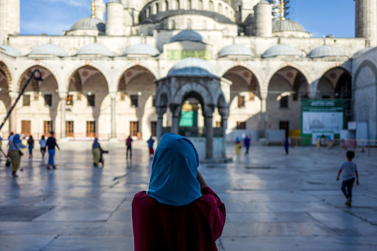 Sultan Ahmet Mosque Sultan Ahmed Mosque Adult Arch Architecture Belief Building Building Exterior Built Structure Day Focus On Foreground Group Of People Incidental People Lifestyles People Place Of Worship Real People Rear View Religion Spirituality Walking