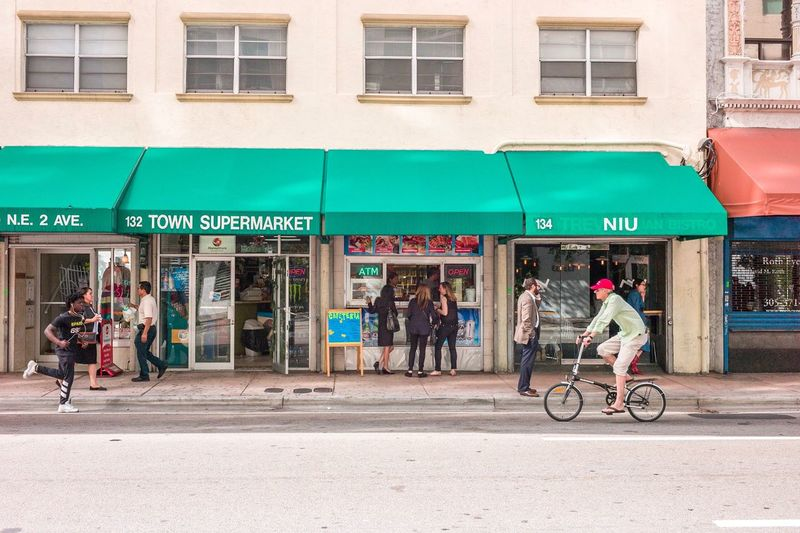 Salvo . Building Exterior City Bicycle Women Architecture Built Structure Full Length Adults Only Transportation Outdoors Store Streetphotography Tourism Straight Photography Street Photography People City Life Cycling Adult Text Men Young Women Sky Day