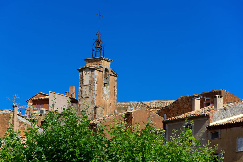 village roussillon Church France Provence Tree Wach Tower Architecture Bell Tower Bell Tower - Tower Blue Blue Sky Building Exterior Built Structure Campanile Clear Sky Day House Low Angle View No People Outdoors Red Clay Red Wall Roofs Roussillon Stone Wall Tree