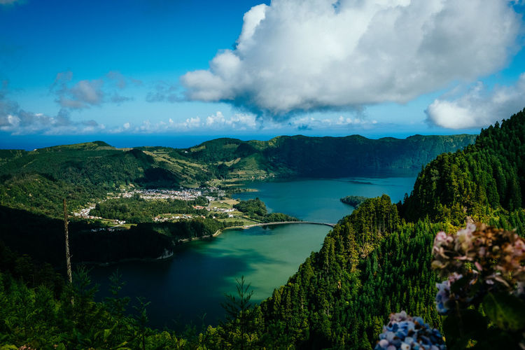 The beautiful view above the Sete Cidades on Sao Miguel Water Sky Tranquility Plant Beauty In Nature Tranquil Scene Cloud - Sky Scenics - Nature Tree Nature No People Mountain Sea Non-urban Scene Green Color Day Idyllic Land Outdoors Bay Nature_collection Nature Photography Landscape_Collection Landscape_photography