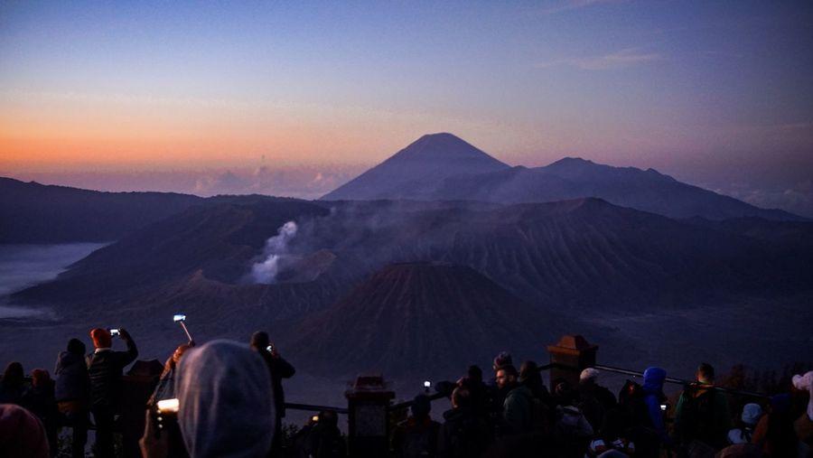 People at bromo-tengger-semeru national park against sky during sunset
