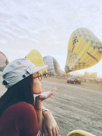 Hot Air Balloons balloons Sky yellow Lifestyles Leisure Activity Real People Outdoors One Person Protective Workwear Day Headwear People Adult First Eyeem Photo
